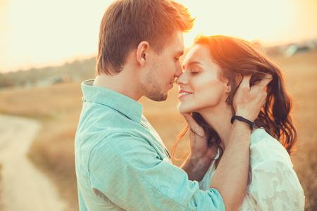 56182169 - young couple in love outdoor.stunning sensual outdoor portrait of young stylish fashion couple posing in summer in field